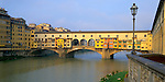 Florence, Tuscany, Italy<br /> Colorful overhanging shop windows of the Ponte Vecchio on the Arno River