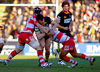 Ben Jacobs is double-tackled by Alasdair Strokosch and Eliota Fuimaono-Sapolu. Guinness Premiership match between London Wasps and Gloucester on March 7, 2010 at Adams Park in High Wycombe, England. [Mandatory Credit: Patrick Khachfe/Onside Images]
