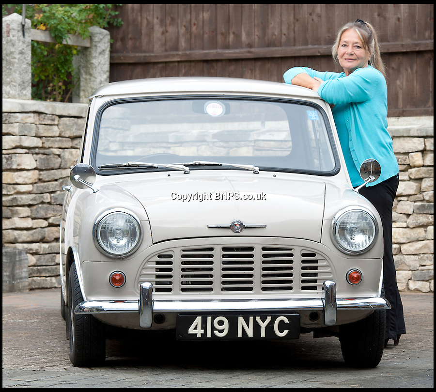 BNPS.co.uk (01202) 558833<br /> Picture: LauraJones/BNPS<br /> <br /> Owner of the Mini pickup truck Margaret Gould from Broadstone, Poole, Dorset.<br /> <br /> A classic Mini pickup truck is being sold for only the second time in its life with a pre-sale estimate of £13,000.<br /> <br /> The 1961 open back vehicle has been owned by the same family since its was bought new by farmer Minnie Gould who used it to transport calves to market. <br /> <br /> It was given a new lease of life 30 years later by her son Fred who had it recommissioned and resprayed.
