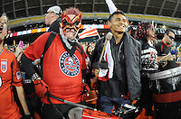 D.C. United midfielder Andy Najar (14) celebrating with fans during the game. D.C. United tied the Seattle Sounders, 0-0 at RFK Stadium, Saturday April 7, 2012.