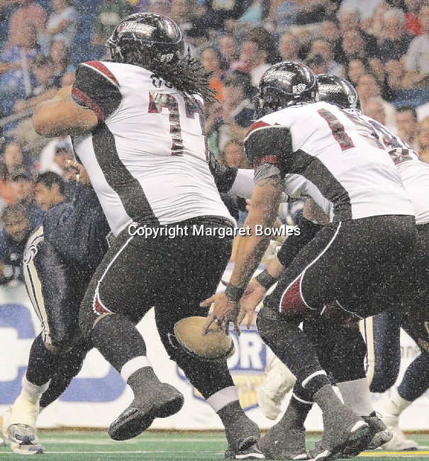 05 June 2010: Oklahoma City quarterback Tommy Grady loses the ball on the handoff, and Tampa recovers for a touchdown in the fourth quarter. The Tampa Bay Storm defeated the Oklahoma City Yard Dawgz 50-48 at the St. Pete Forum in Tampa, Florida