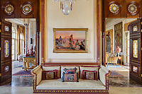 The opulent 19th century apartment  exudes sensuality, fantasy and passion. In the transitional space between the two living rooms, symmetry plays an important role. The Ottoman-style daybed was made by Ateliers Joe Tohmé and the 19th century painting, A Dance at Sunset, is by Swiss artist Otto Pilny.