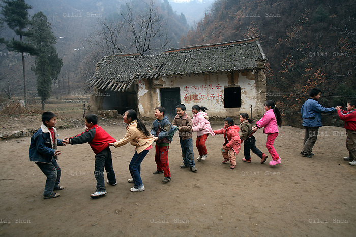 Young students play recess at their school in a village near Xi'an, China on 06 March, 2008.
