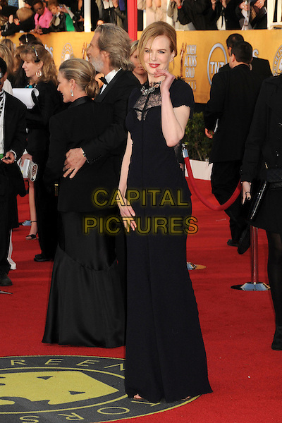 NICOLE KIDMAN.17th Annual Screen Actors Guild Awards held at The Shrine Auditorium, Los Angeles, California, USA..January 30th, 2011.SAG arrivals  full length black dress lace panel maxi feather collar trim hand waving .CAP/ADM/BP.©Byron Purvis/AdMedia/Capital Pictures.