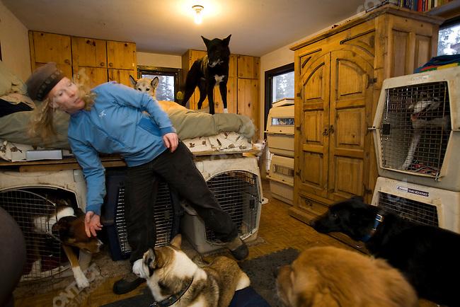 Dog musher Jill Garnet, at home with her dogs. Kasilof, Alaska, December 21, 2008.