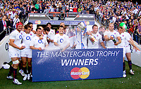 The England squad celebrate winning the MasterCard Trophy by emerging victorious with a 35-26 scoreline. MasterCard Trophy International match between England and the Barbarians on May 30, 2010 at Twickenham Stadium in London, England. [Mandatory Credit: Patrick Khachfe/Onside Images]