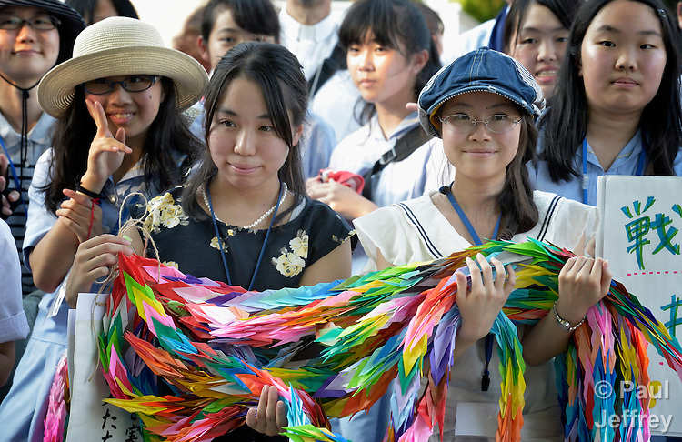 Japanese children from an Anglican school in Osaka display folded paper cranes they have brought to Hiroshima in commemoration of the 70th anniversary of the U.S. dropping an atomic bomb on the Japanese city of Hiroshima. The cranes are a sign of hope and peace.