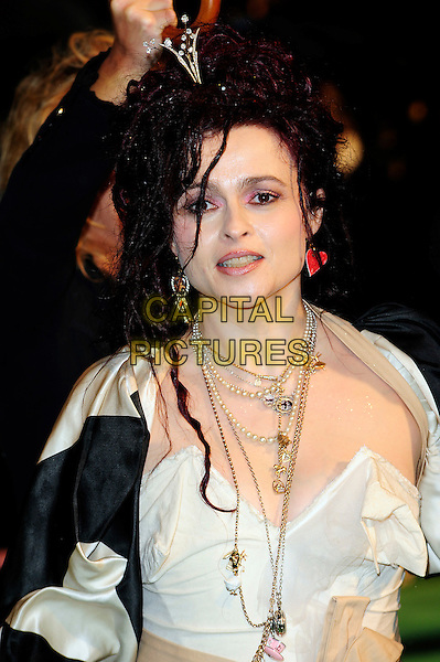 "HELENA BONHAM CARTER .Arriving at the Royal World Film Premiere of ""Alice In Wonderland"", Odeon cinema Leicester Square, London, England, February 26th 2010. arrivals portrait headshot black and white cream beige striped jacket bow sash necklace beads charms peals Vivienne Westwood red heart earring hair clip tiara earrings mismatched make-up .CAP/CJ.©Chris Joseph/Capital Pictures."