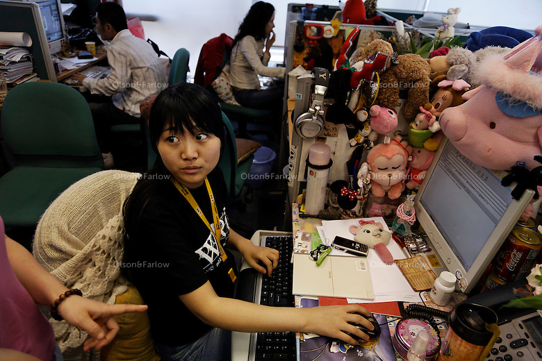 SOHU.com wants to be the Yahoo of China. They are one of the sponsors of the Beijing Summer Olympics 2008.  There are photographs of a make up room and studio for their online TV show.  The star of SOHU.com is Da Peng and he is on the right getting his hair done before taping a show...Contact is: Eva Liu, Marketing Specialist, SOHU.com +86 10 6272  6357 mobile is +86 134 0108 5157.evaliu@soho.inc.com