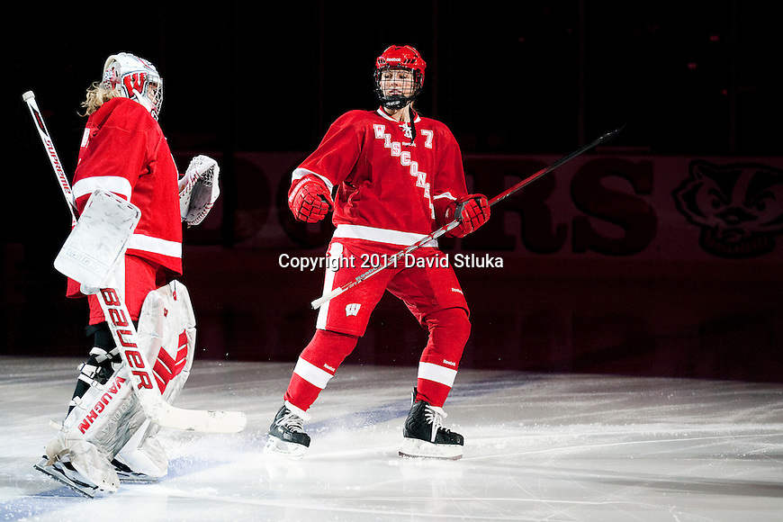 Wisconsin Badgers goalie Alex Rigsby (33) and Kelly Jaminski (7) during introdurction prior to an NCAA Women's College Hockey game against Lindenwood University Lions on September 23, 2011 in Madison, Wisconsin. The Badgers won 11-0. (Photo by David Stluka)