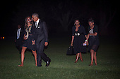 United States President Barack Obama and the First Family walk toward the White House after disembarking Marine One on the South Lawn of the White House in Washington, District of Columbia, U.S., on Sunday, August 31, 2014. The First Family traveled to Westchester County, New York to attend the wedding of senior policy advisor for nutrition policy and Let's Move Executive Director, Sam Kass to MSNBC host Alex Wagner. From left to right: Malia Obama, President Obama, first lady Michelle Obama, and Sasha Obama.<br /> Credit: Pete Marovich / Pool via CNP