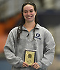 Morgan Rinn of Oceanside poses for pictures after winning the 100-yard butterfly event in the Nassau County girls swimming championships and state qualifier meet at Nassau Aquatic Center in East Meadow on Saturday, Nov. 3, 2018.