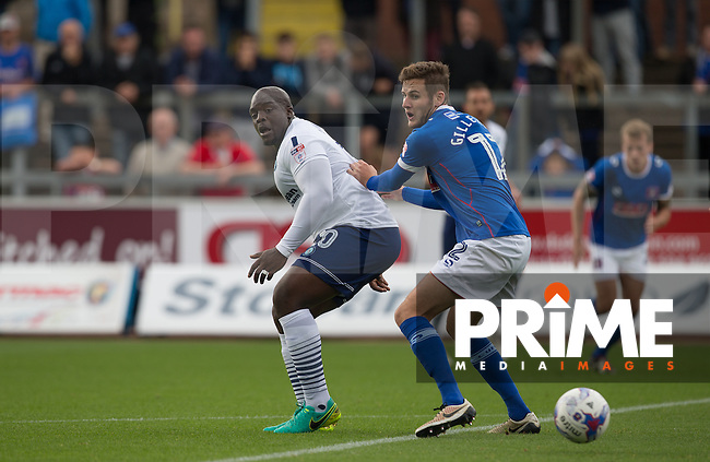 Adebayo Akinfenwa of Wycombe Wanderers turns under pressure from Macaulay Gillesphey of Carlisle United  during the Sky Bet League 2 match between Carlisle United and Wycombe Wanderers at Brunton Park, Carlisle, England on 24 September 2016. Photo by Andy Rowland.