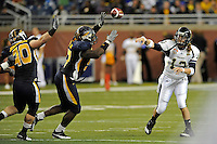 26 December 2010:  FIU quarterback Wesley Carroll (13) passes in the second half as the FIU Golden Panthers defeated the University of Toledo Rockets, 34-32, to win the 2010 Little Caesars Pizza Bowl at Ford Field in Detroit, Michigan.