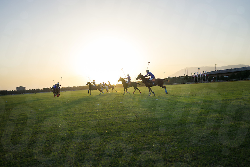 June 13, 2014 - Tehran (Iran). Female polo players during a match of the 83rd Federation of the International Polo Ambassadors' Cup, organised in a field located in the south of Tehran. Among the participants, Morgan Ru, the first American woman to play polo in Iran. © Thomas Cristofoletti / Ruom