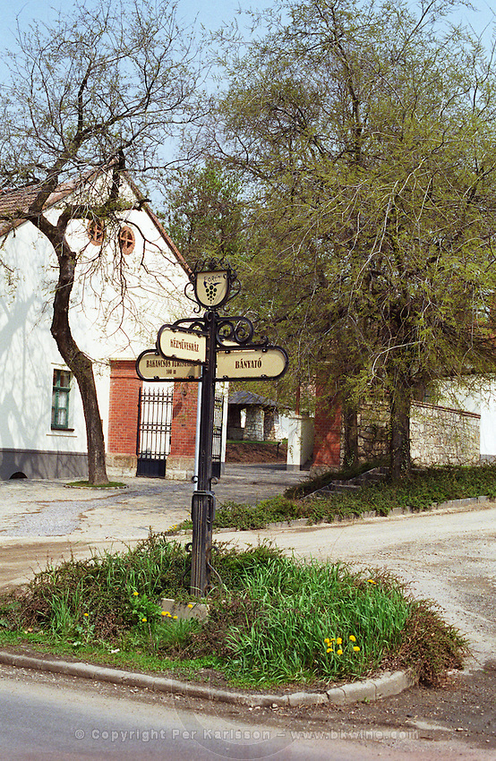 """In front of The Kiralyudvar winery in the village Tarcal: the signs indicate the different wineries in the village: """"borut"""" Kezmuveshaz, Banyato.... Kiralyudvar (meaning """"King's Court"""")is run by Istvan Szepsy, considered maybe the best winemaker in Tokaj. he also makes Tokaj under his own name.  Credit Per Karlsson BKWine.com"""