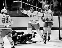 Seals Bob Murdoch scores with Dennis Maruk and Al MacAdam. vs. Buffalo Sabers. (1976 photo/Ron Riesterer)
