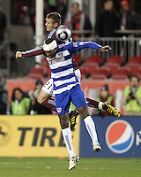 Atiba Harris#16 of FC Dallas loses a header to Julien Baudet#21 of the Colorado Rapids during MLS Cup 2010 at BMO Stadium in Toronto, Ontario on November 21 2010. Colorado won 2-1 in overtime.