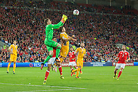 Wayne Hennessey of Wales wins an aerial challenge under pressure from Alexandru Dedov of Moldova during the FIFA World Cup Qualifier match between Wales and Moldova at Cardiff City Stadium, Cardiff, Wales on 5 September 2016. Photo by Mark  Hawkins.