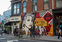 "New York, USA. 23rd Aug, 2017. Passersby stop to admire a newly completed mural, by Shepard Fairey, in the East Village. The mural features Debbie Harry, lead singer for the rock group Blondie, who got their start in 1979 at CBGB which was located across the street. Fairy's work is also featured in Blondie's latest album ""Polinator"" which was released in May 2017 Credit: Stacy Walsh Rosenstock/Alamy Live News"