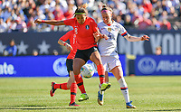 CHICAGO, IL - OCTOBER 06: Becky Sauerbrunn #4 of the United States and CHO SO-HYUN #8 of Korea Republic battle for a ball during a game between the USA and Korea Republic at Soldier Field, on October 06, 2019 in Chicago, IL.