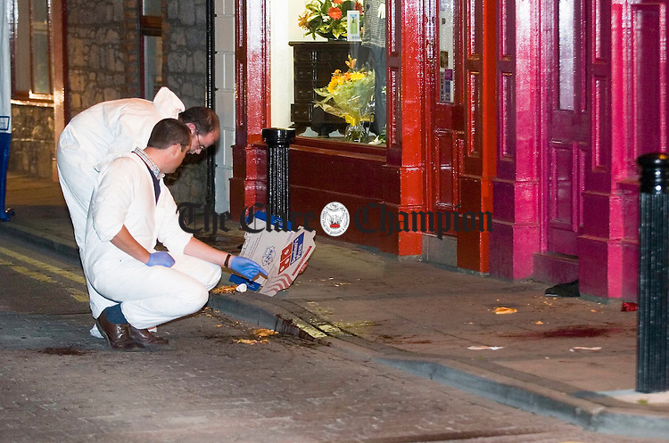 Gardai examine the bloodied scene where an incident took place on Parnell street, Ennis on Thursday evening. Photograph by John Kelly.