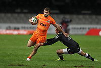 DURBAN, SOUTH AFRICA - JULY 14: Curwin Bosch of the Cell C Sharks with a miss tackle on Ramiro Moyano of the Jaguares during the Super Rugby match between Cell C Sharks and Jaguares at Jonsson Kings Park on July 14, 2018 in Durban, South Africa. Photo: Steve Haag / stevehaagsports.com