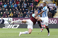 Burnley's Sam Vokes vies for possession with Huddersfield Town's Mathias Zanka Jorgensen<br /> <br /> Photographer Rich Linley/CameraSport<br /> <br /> The Premier League - Burnley v Huddersfield Town - Saturday 6th October 2018 - Turf Moor - Burnley<br /> <br /> World Copyright &copy; 2018 CameraSport. All rights reserved. 43 Linden Ave. Countesthorpe. Leicester. England. LE8 5PG - Tel: +44 (0) 116 277 4147 - admin@camerasport.com - www.camerasport.com