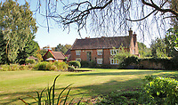 BNPS.co.uk (01202 558833)<br /> Pic Savills/BNPS<br /> <br /> The house is Grade II listed.<br /> <br /> Heard it through the grapvine? - Kent property comes with a 4500 bottle vinyard.<br /> <br /> A charming farmhouse has emerged for sale which is perfect for wine lovers - as it has its own vineyard.<br /> <br /> Ulley Farmhouse in Kennington, Kent, comes with the neighbouring vineyard which produces 3,500 bottles of sparkling rose wine and 1,000 bottles of still rose each year.<br /> <br /> The vines were planted on the 5.75 acre farm by Chris and Rachel Newman 10 years ago, who have sold the wine through farmers markets.<br /> <br /> They are selling the property with estate agents Savills who have given it a pricetag of £1.35million.<br /> <br /> The Grade II listed five bedroom farmhouse dates back to the 16th century, with some later alterations.