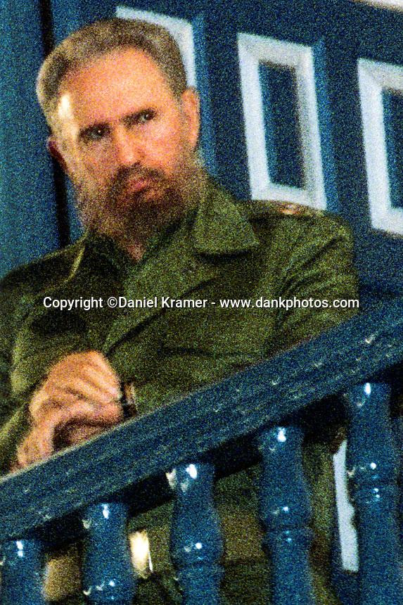 Fidel Castro checks his watch before his speech celebrating the 40th anniversary of the Cuban revolution in Santiago de Cuba on Dec. 31, 1998.