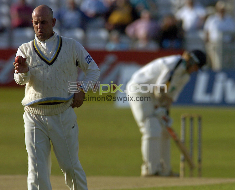 PICTURE BY VAUGHN RIDLEY/SWPIX.COM -  Cricket - Liverpool Victoria County Championship, Day Two - Yorkshire v Hampshire - Headingley, Leeds, England - 01/06/06...? Simon Wilkinson - 07811 267706...Yorkshire's Darren Lehman inspects the ball.