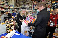 Pictured: Gylfi Sigurdsson with girlfriend Alexandra Ivarsdottir Wednesday 08 December 2016<br />Re: Swansea City FC players have bought Christmas gifts for 60 children at Smyths toy store in Swansea, south Wales.