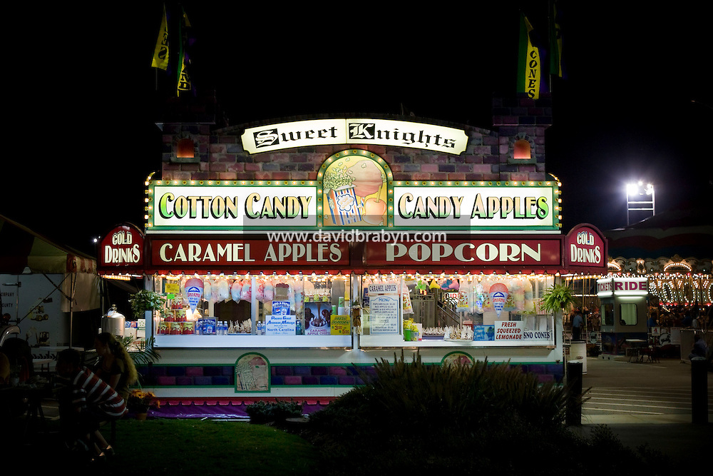 View of a food vendor stand selling cotton candy, candy apple, caramel apples and popcorn at the North Carolina State Fair in Raleigh, NC, United States, 16 October 2008.