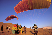 © Caroline Penn / Panos Pictures..Iranian women in sport..Near Tehran, Iran. October 1999...Practice session of the Ladies' Paragliding Club.