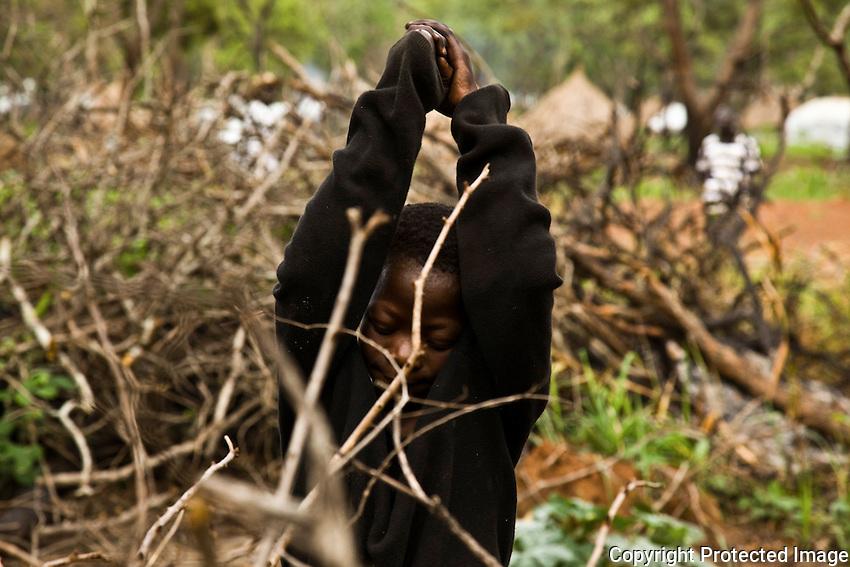 refugee child collecting firwood in Makpandu camp, South Sudan
