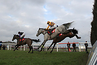 The field in jumping action in the Kempton.co.uk Graduation Chase - Horse Racing at Kempton Park Racecourse