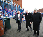 Rangers team mates Willie Johnston, Colin Stein and Tam Forsyth after paying their respects to Sandy Jardine at the Copland Road blue gates at Ibrox