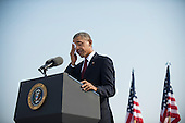 United States President Barack Obama wipes his face as he delivers remarks during a remembrance ceremony for the 12th anniversary of the 9/11 terrorist attacks, at the Pentagon on September 11, 2013 in Arlington, Virginia. <br /> Credit: Kevin Dietsch / Pool via CNP