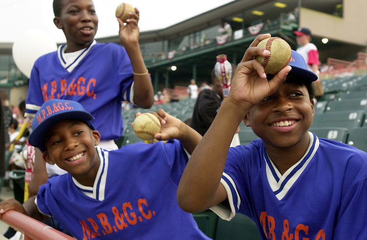 11baseball.tw0612101 --From left, Clifford Brown, Eric Beamon and Corey Lewis of the 14 Raiders from DC, taunt friends with practice balls they received from players at the 40th Annual Congressional Roll Call baseball game.