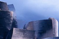 The soaring irregular curved forms of Gehry's Guggenheim Museum in Bilbao are covered in titanium panels which resemble fish scales