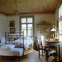 A patchwork quilt covers the wrought-iron bed in this enchanting child'd bedroom