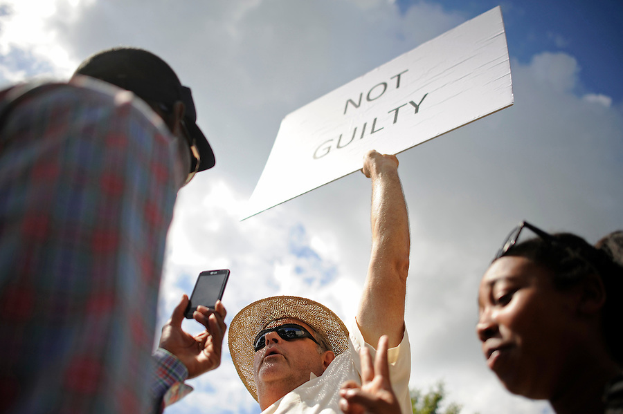 Demonstrators have a heated argument about the guilt of George Zimmerman as they gather and wait for a verdict in the trial of Zimmerman at the Seminole County Criminal Justice Center in Sanford, Florida, USA, 13 July 2013. Zimmerman, a former volunteer neighborhood watch captain, had been charged with second-degree murder in the 26 February 2012 shooting death of 17 year-old Trayvon Martin in Sanford, Florida.
