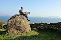 Artist Jerry Cahir painting at Cill Rialaigh, County Kerry.. Photo: Don MacMonagle