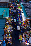 Pictured: Hundreds of fish traders sell newly caught fish in bright colourful boxes to buyers at night in the  Long Hai fish market in Vietnam. <br /> <br /> Thousands of customers flock from across Vietnam to buy fish being sold at the market, which runs from midnight to around 6am. <br /> <br /> The spectacular shots were captured by photography Trung Anh. <br /> <br /> The daily market is the largest in the Vung Tau Province of Vietnam and sell wholesale fish to shop owners across the region. <br /> <br /> Please byline: Trung Anh/Solent News<br /> <br /> © Trung Anh/Solent News & Photo Agency<br /> UK +44 (0) 2380 458800