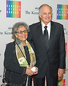 Arlene and Alan Alda arrive for the formal Artist's Dinner honoring the recipients of the 2013 Kennedy Center Honors hosted by United States Secretary of State John F. Kerry at the U.S. Department of State in Washington, D.C. on Saturday, December 7, 2013. The 2013 honorees are: opera singer Martina Arroyo; pianist,  keyboardist, bandleader and composer Herbie Hancock; pianist, singer and songwriter Billy Joel; actress Shirley MacLaine; and musician and songwriter Carlos Santana.<br /> Credit: Ron Sachs / CNP