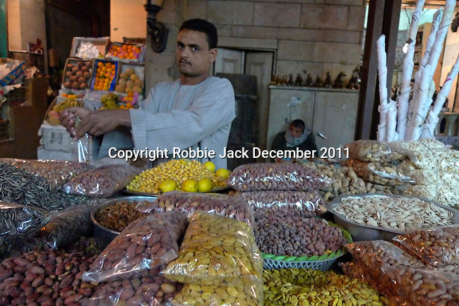 Man selling nuts in the Sharia Souk in Luxor.The town of Luxor occupies the eastern part of a great city of antiquity which the ancient Egytians called Waset and the Greeks named Thebes.
