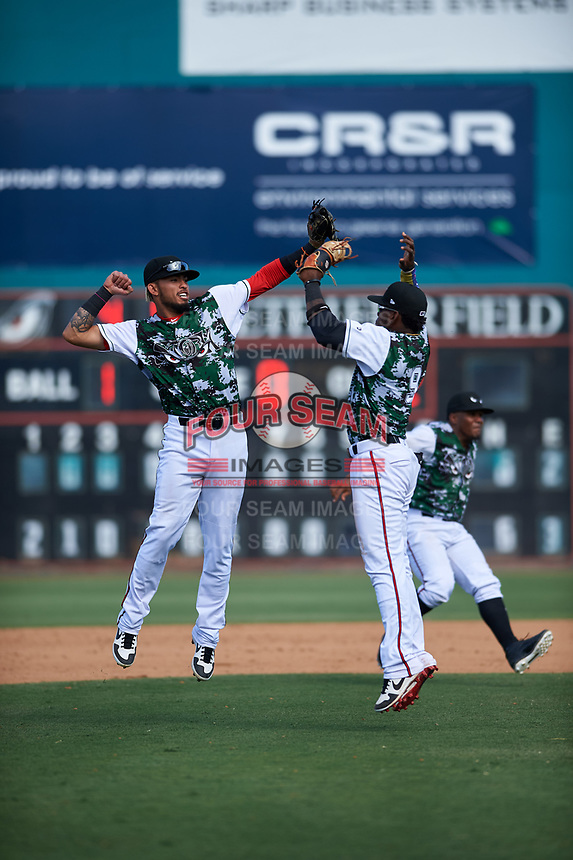 Lake Elsinore Storm infielders Gabriel Arias (13) and Olivier Basabe (9) celebrate a victory after a California League game against the Inland Empire 66ers on April 14, 2019 at The Diamond in Lake Elsinore, California. Lake Elsinore defeated Inland Empire 5-3. (Zachary Lucy/Four Seam Images)