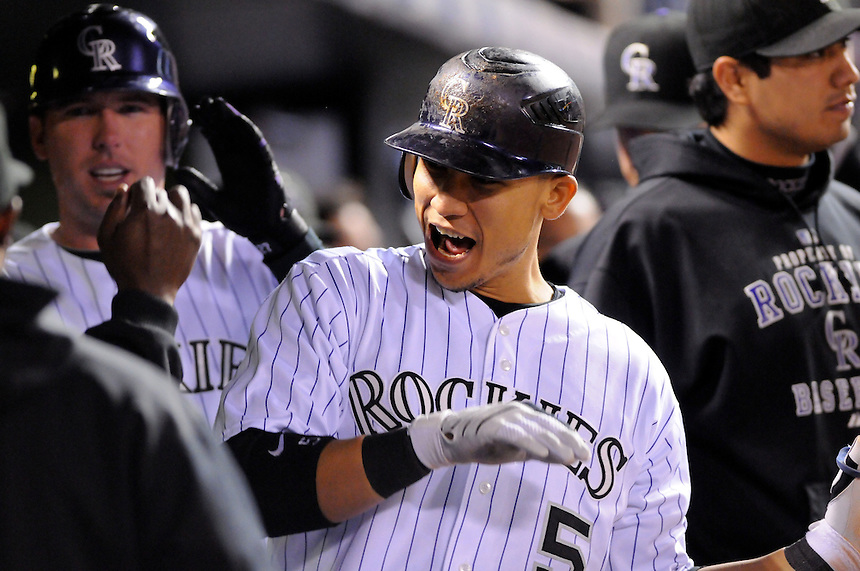 September 30, 2009: Rockies outfielder Carlos Gonzalez celebrates hitting his 13th homerun of the year with teammates in the dugout during a regular season game between the Milwaukee Brewers and the Colorado Rockies at Coors Field in Denver, Colorado. The Rockies beat the Brewers 10-6, and lead the wild card race over Atlanta by 4 games, with 4 games to play. Gonzalez's homer was one of three for the Rockies. *****For editorial use only*****