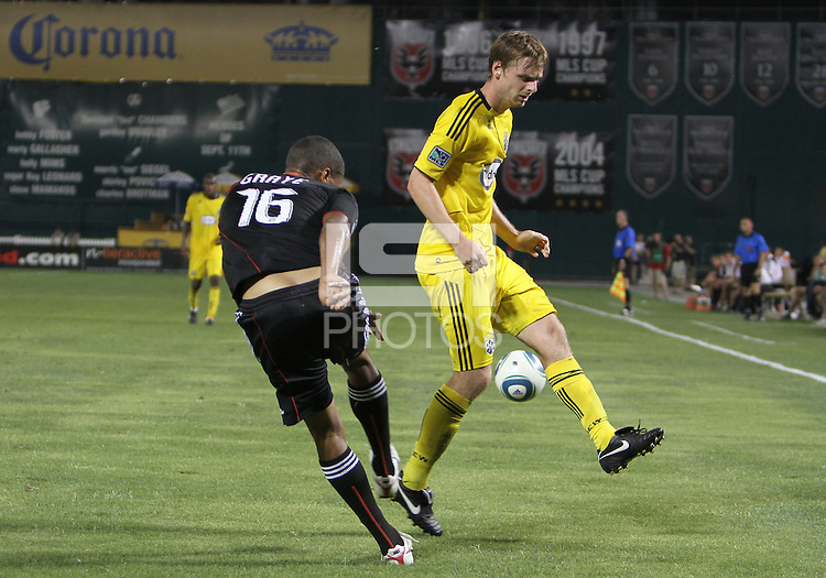 Jordan Graye #16 of D.C. United boots the ball past Eddie Gaven #12 of the Columbus Crew during a US Open Cup semi final match at RFK Stadium on September 1 2010, in Washington DC. Columbus won 2-1 aet.