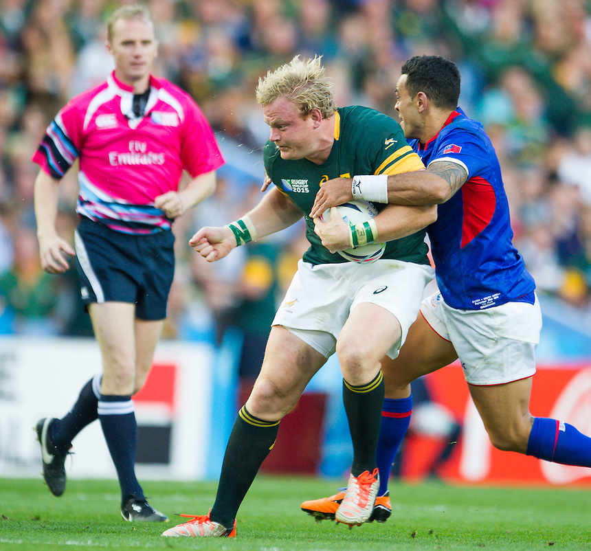 South Africa's Adriaan Strauss is tackled by Samoa's Kahn Fotuali'i<br /> <br /> Photographer Craig Thomas /CameraSport<br /> <br /> Rugby Union - 2015 Rugby World Cup Pool B  South Africa v Samoa - Saturday 26th September 2015 - Villa Park - Birmingham<br /> <br /> &copy; CameraSport - 43 Linden Ave. Countesthorpe. Leicester. England. LE8 5PG - Tel: +44 (0) 116 277 4147 - admin@camerasport.com - www.camerasport.com